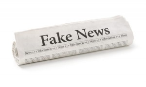 72750644 - rolled newspaper with the headline fake news