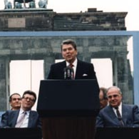 President Ronald Reagan delivering his 1987 speech in front of the Berlin Wall.